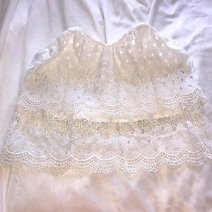 Strapless lace-like crop top with front boning